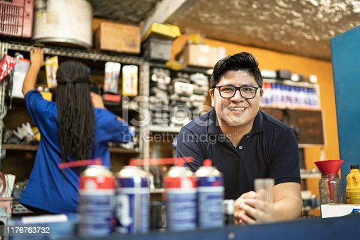 Portrait of a mechanic working in a auto repair shop
