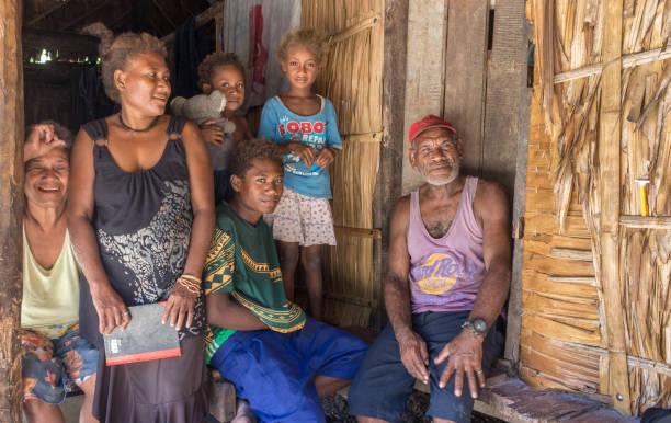 Portrait of a melanesian family. Owaraha, Solomon Island. stock photo