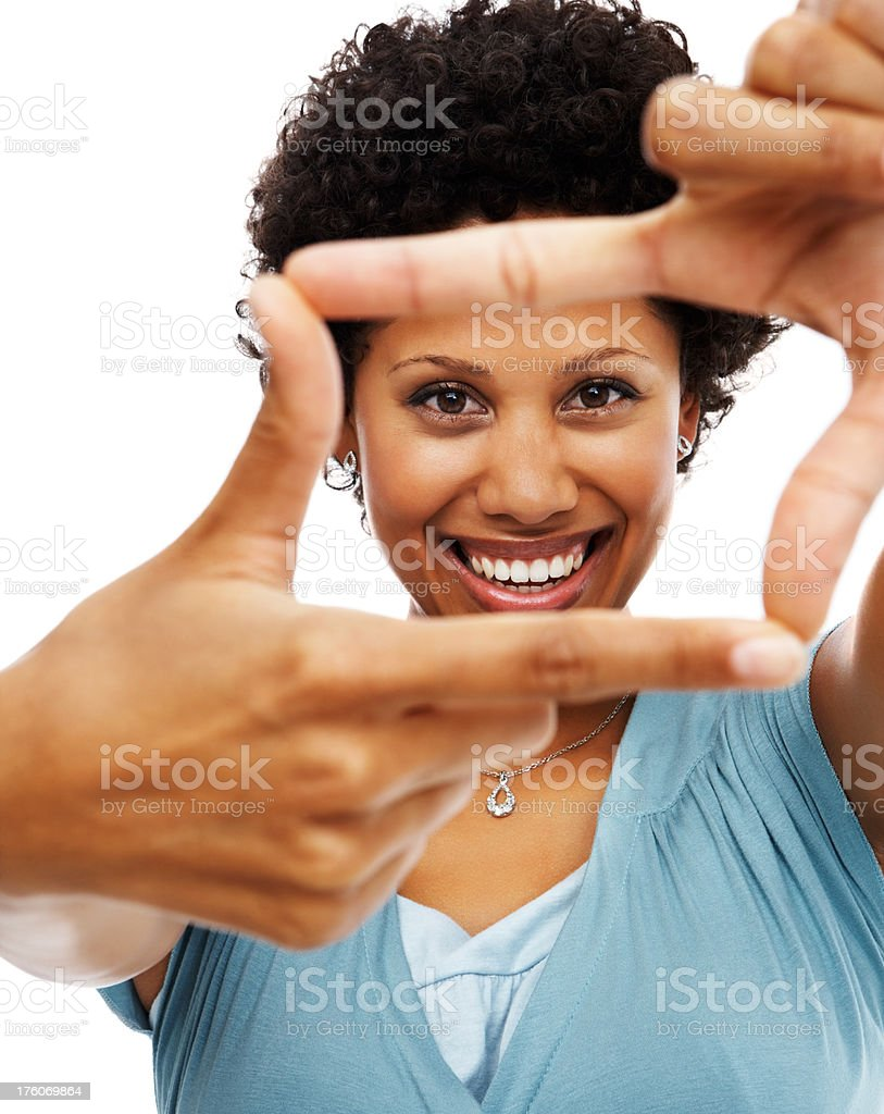 Portrait of a mid adult woman making hand frame royalty-free stock photo