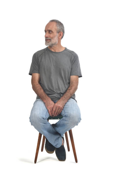 portrait of a middle aged man portrait of middle aged man sitting  on white one senior man only stock pictures, royalty-free photos & images