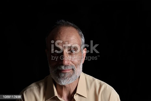 istock portrait of a middle aged man 1059112938