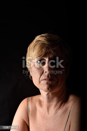 istock portrait of a middle aged woman 1038774112