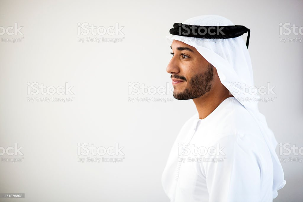 Portrait of a Middle Eastern man smiling to the left stock photo