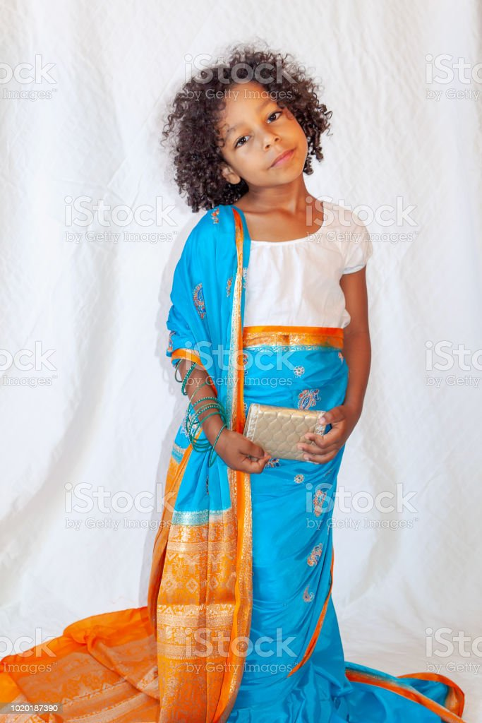 Portrait of a mixed ethniсity little girl with curly hair stock photo