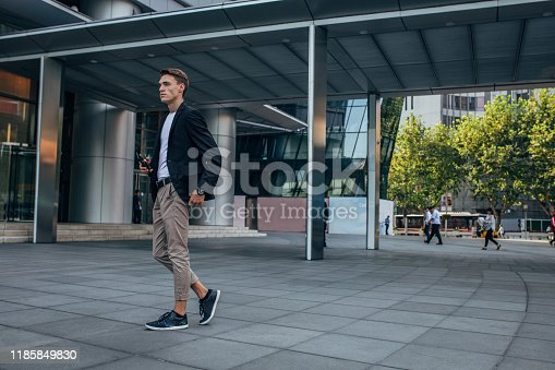 Modern young man standing outdoors.