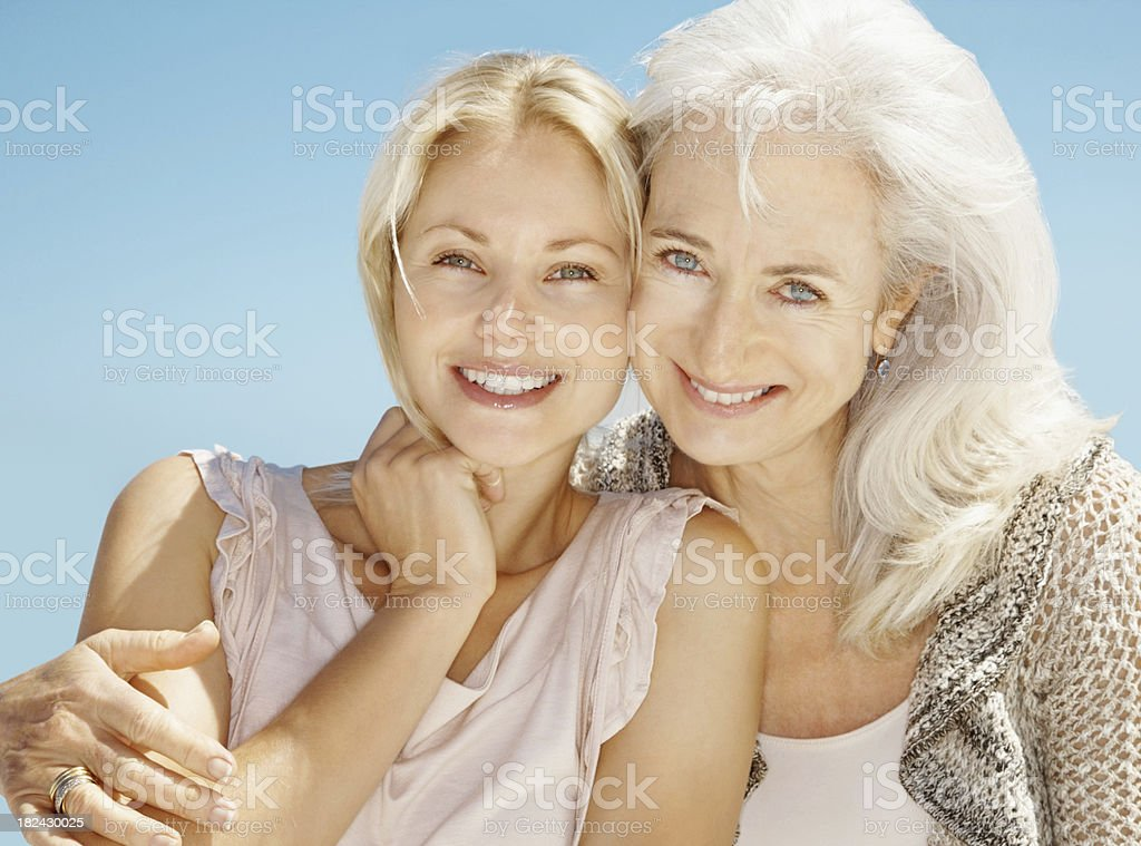Portrait of a mother and daughter smiling royalty-free stock photo