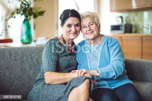 916556066 istock photo Portrait of a mother and her adult daughter 1037524742