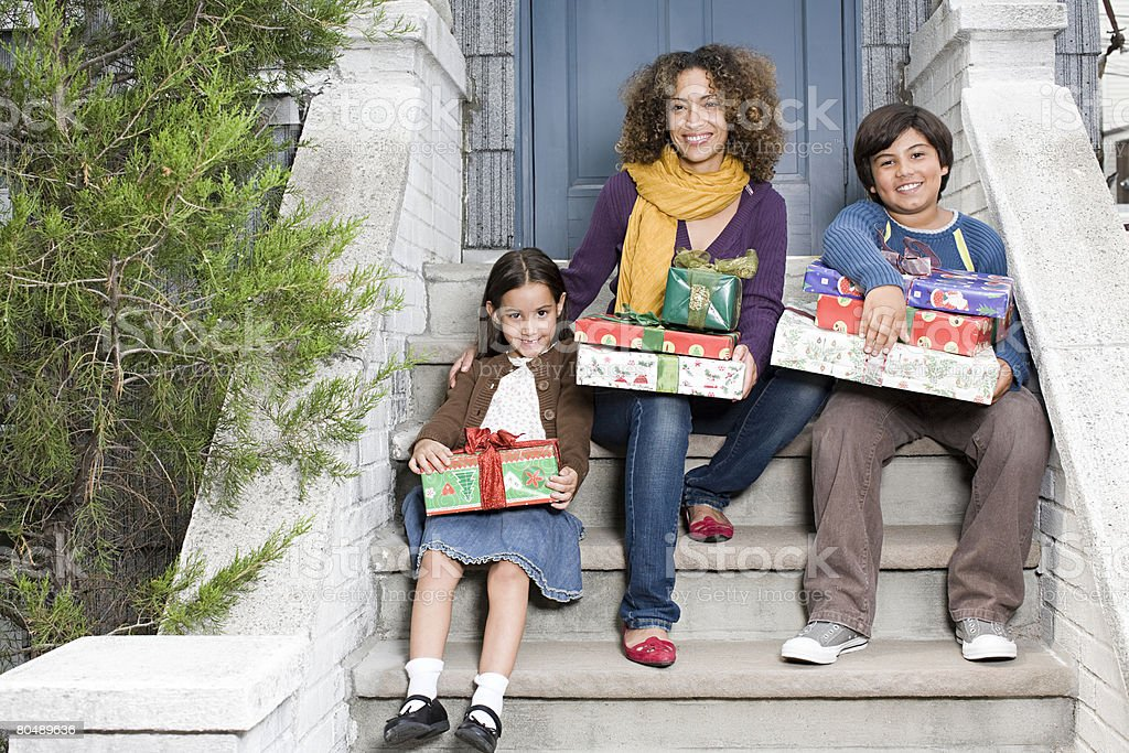 Portrait of a mother and her children with gifts 免版稅 stock photo
