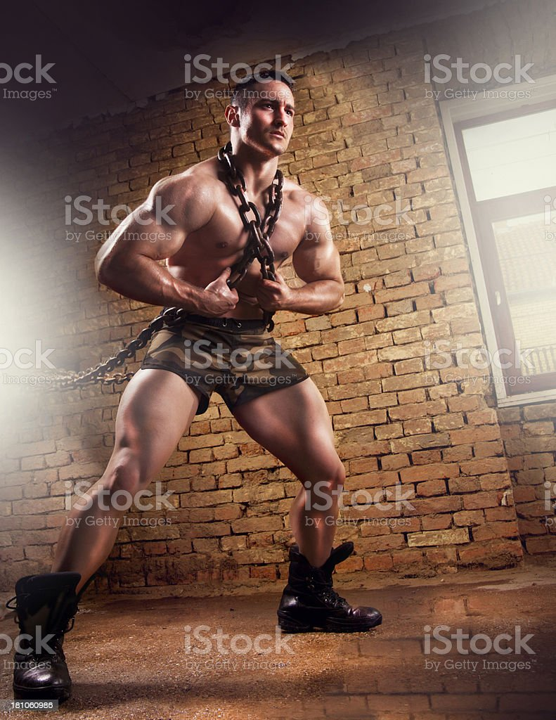 Portrait of a muscular man in chains stock photo