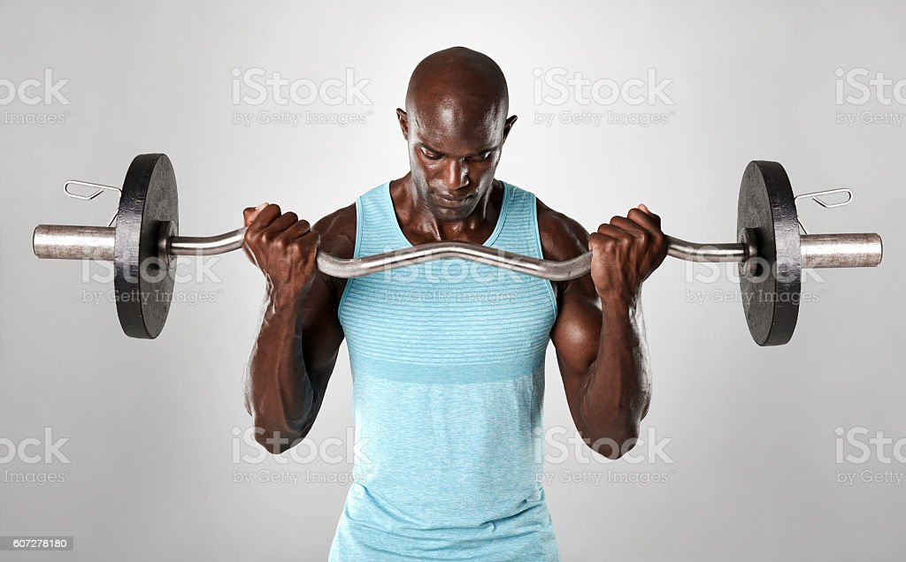 Portrait of a muscular man lifting barbell stock photo