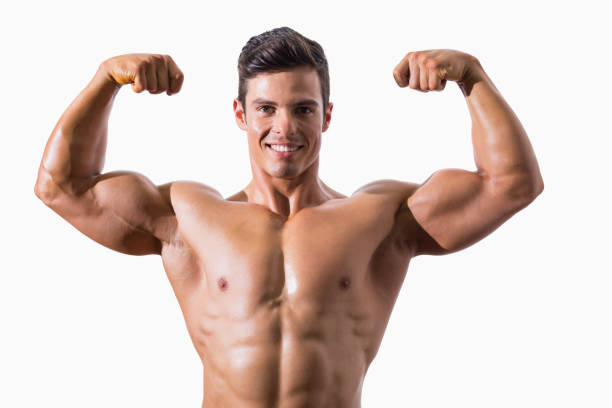 Portrait of a muscular young man flexing muscles Portrait of a muscular young man flexing muscles over white background flexing muscles stock pictures, royalty-free photos & images