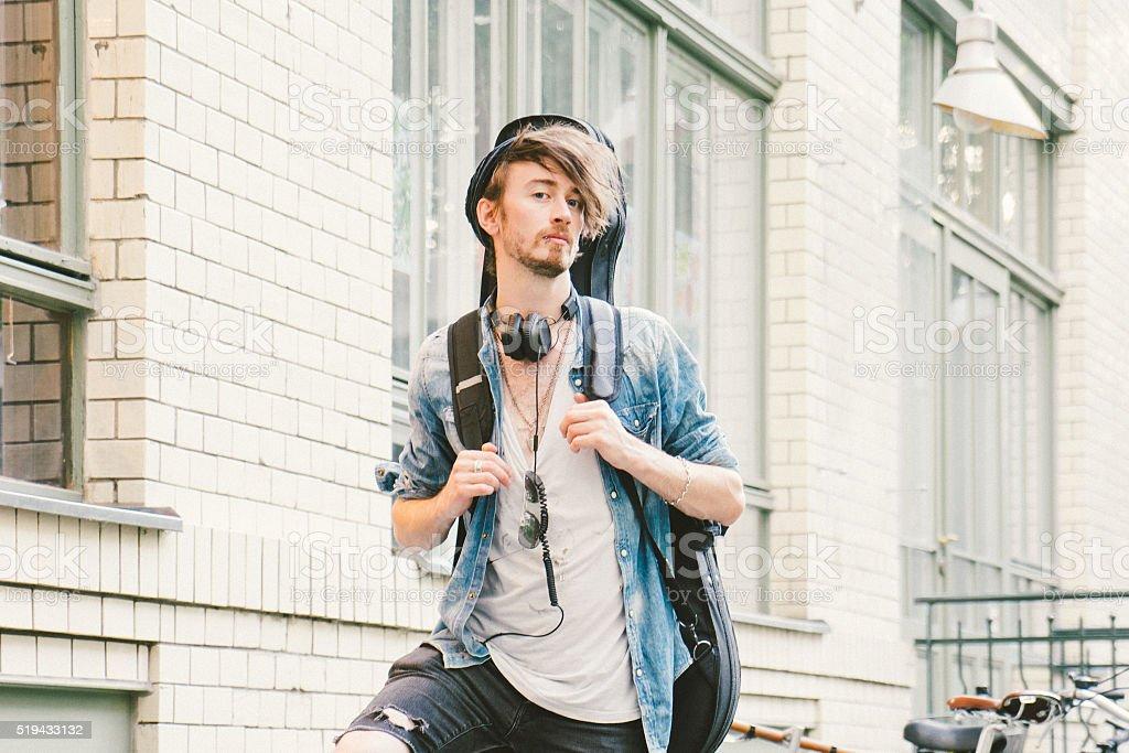 Portrait Of A Musician In Urban Landscape stock photo