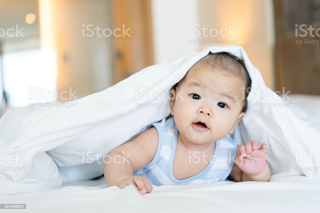 Portrait of a newborn Asian baby on the bed stock photo
