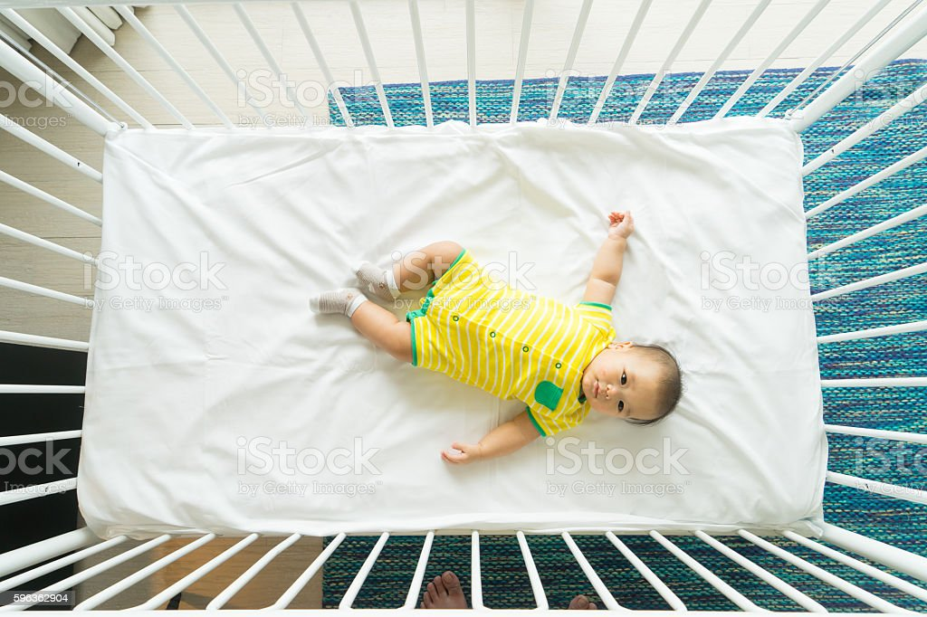 Portrait of a newborn Asian baby on the bed royalty-free stock photo