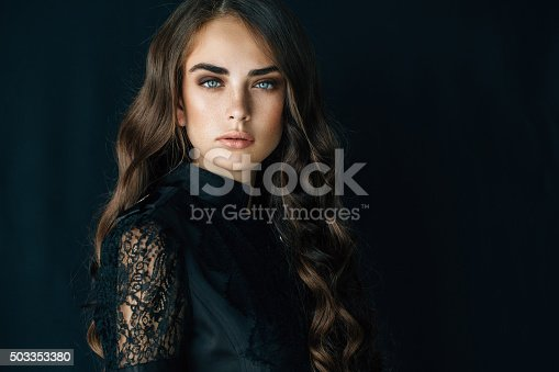 Portrait of a nice looking woman. Professional make-up and hairstyle