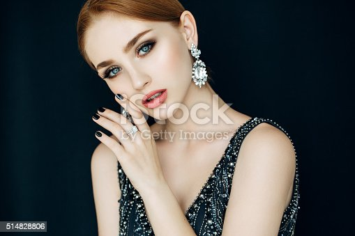 Portrait of a nice looking woman with beautiful ring and earings. Professional make-up
