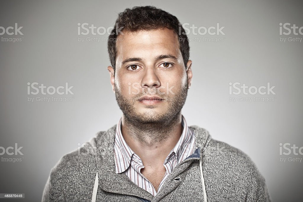Portrait of a normal boy over grey background. stock photo
