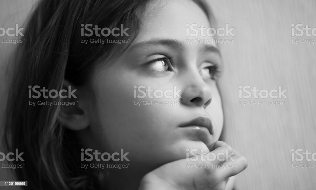 Portrait of a pensive girl isolated