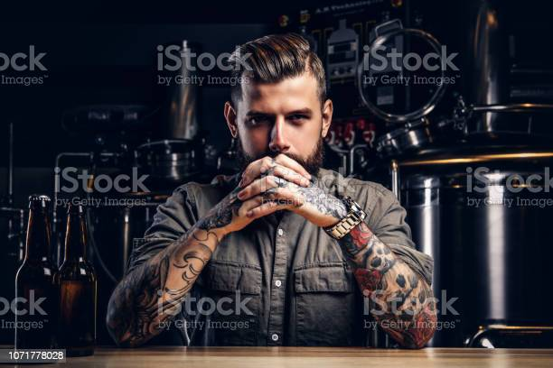 Portrait of a pensive tattooed hipster male with stylish beard and picture id1071778028?b=1&k=6&m=1071778028&s=612x612&h=lqfoctui1tnrxsgaii georqn0o bmrfm4wcp4igpnq=
