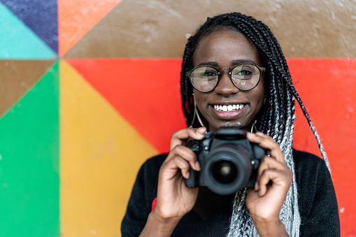 Portrait of a photographer Smiling with Colorful background
