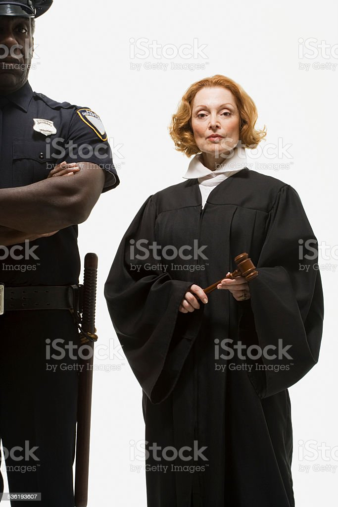 Portrait of a police officer and a judge stock photo