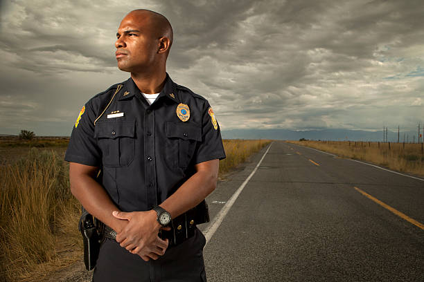 Portrait of a Police Officer Portrait of a police officer. This stock image has a horizontal composition. Arm Badge Create by me, Gold Chest Emblem Custom Ordered Generic police uniform stock pictures, royalty-free photos & images