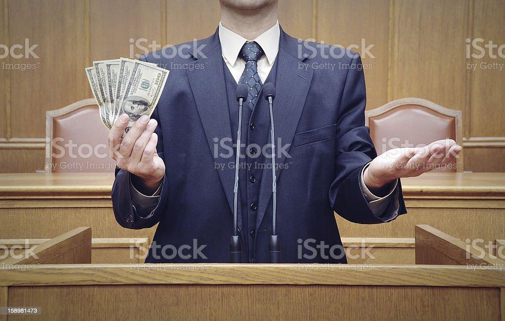 Portrait of a politician holding money stock photo