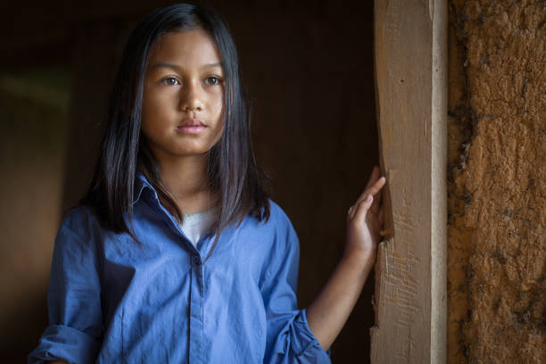 Portrait of a poor little thailand girl lost in deep thoughts, poverty, Poor children Portrait of a poor little thailand girl lost in deep thoughts, poverty, Poor children, War refugees trafficking stock pictures, royalty-free photos & images