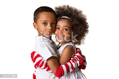 istock Portrait of a preschool african-american siblings hugging each other. isolated 1074272864