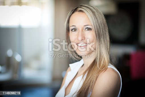 istock Portrait Of A Pretty Blond Woman Smiling At The Camera 1146096219