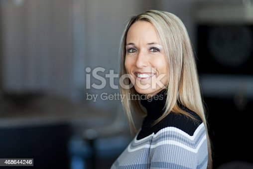 istock Portrait Of A Pretty Blond Woman Smiling At The Camera 468644246