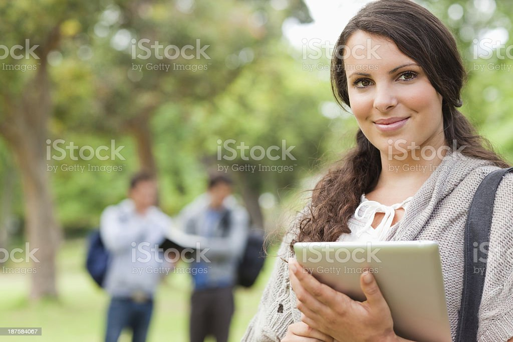 Portrait of a pretty brunette using touch pad royalty-free stock photo