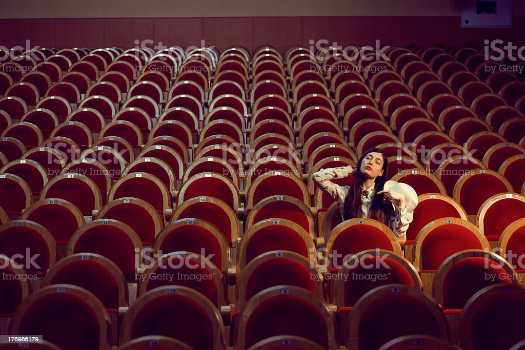 portrait of a pretty girl in  movie theater stock photo