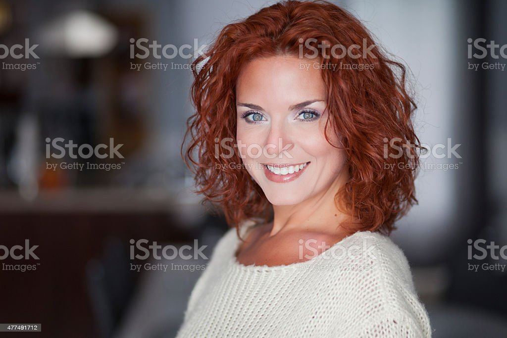 Portrait Of A Pretty Woman Smiling At The Camera stock photo