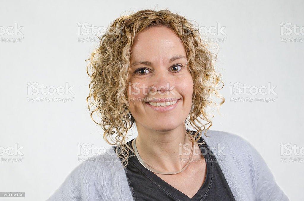 Portrait of a pretty woman smiling in studio white background stock photo
