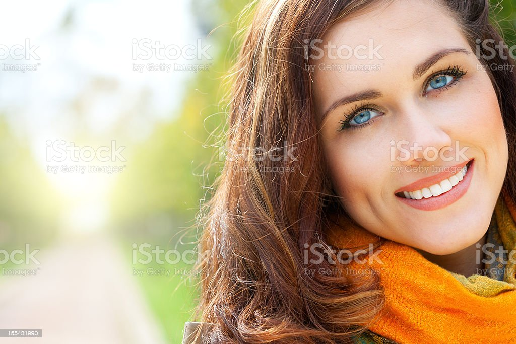 Portrait of a pretty woman wearing a scarf stock photo