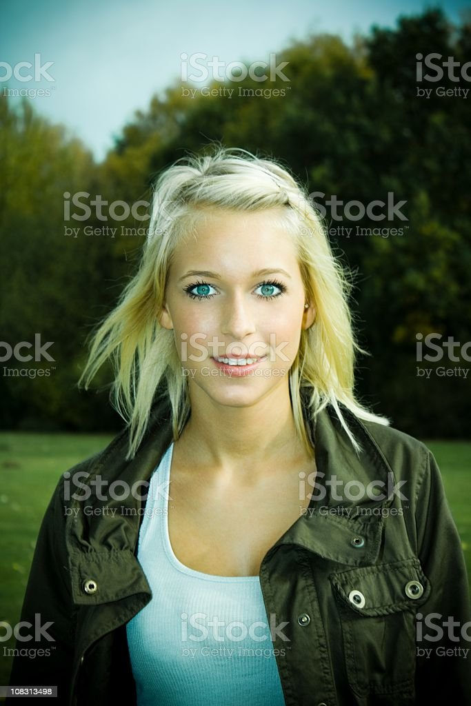Portrait of a pretty young blond woman in the park royalty-free stock photo