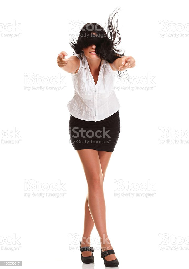 Portrait of a pretty young woman pointing and looking away royalty-free stock photo