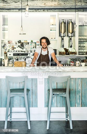1003493404istockphoto Portrait of a professional barista standing in a cafe. Copy space. 1031916036