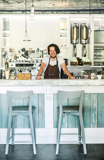 1003493404 istock photo Portrait of a professional barista standing in a cafe. Copy space. 1031916036