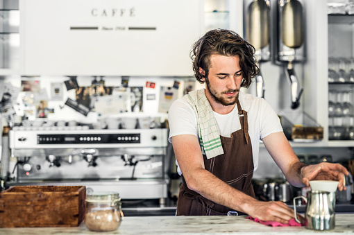 1003493404 istock photo Portrait of a professional barista working in a cafe. Copy space. 991088342
