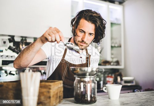 1003493404istockphoto Portrait of a professional barista working in a cafe. 980075738