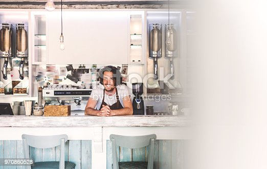 1003493404istockphoto Portrait of a professional bearded barista behind a counter in a cafe. 970860528