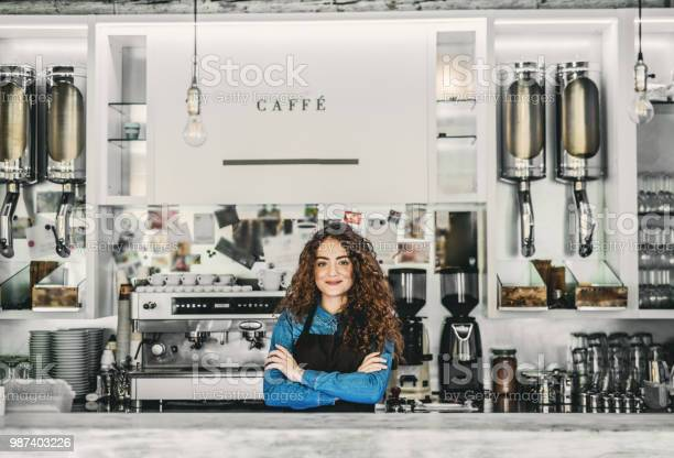 Portrait of a professional young woman barista behind a counter in a picture id987403226?b=1&k=6&m=987403226&s=612x612&h=padbe1umxxpdzwbvo42nlt5zfumk3icqak h9sut8uu=