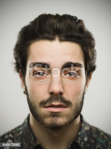istock Portrait of a real crying man 646876580