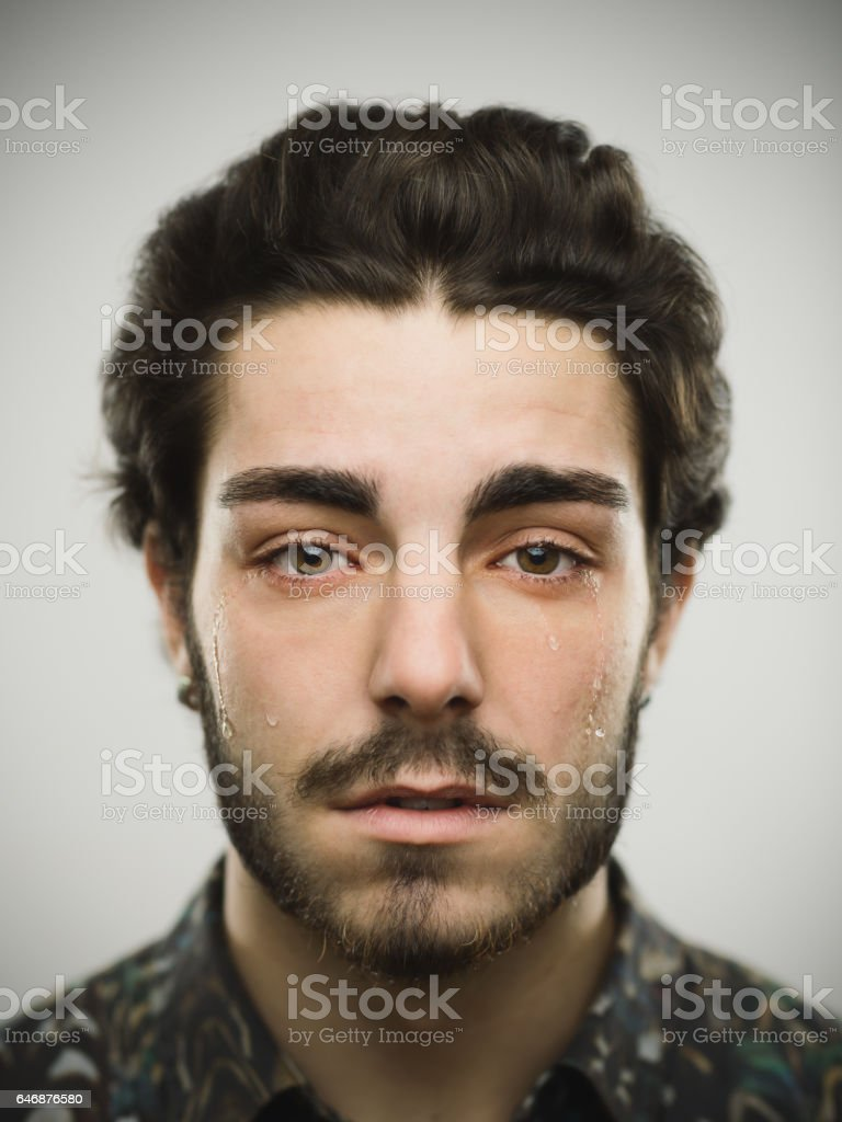 Portrait of a real crying man stock photo
