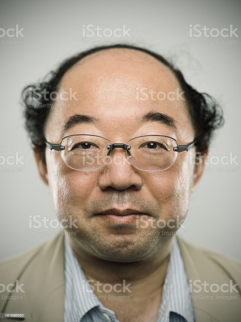 Portrait of a real japanese man with black hair. stock photo
