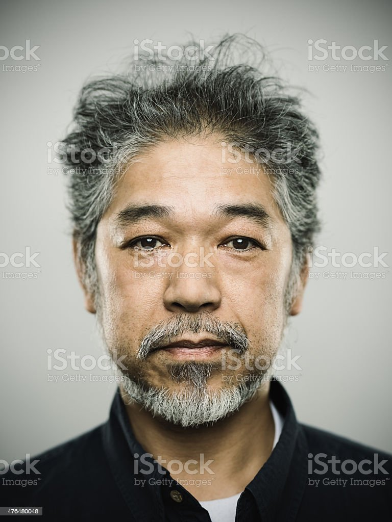 Portrait of a real japanese man with grey hair. stock photo