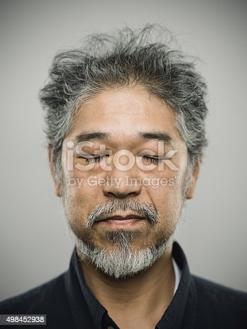 istock Portrait of a real japanese man with grey hair. 498452938