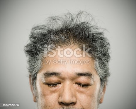 istock Portrait of a real japanese man with grey hair. 499255876